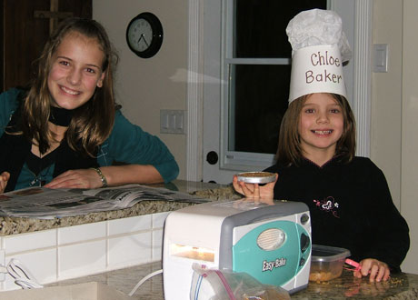 Lauren and Chloe enjoy baking cookies in their new Easy Bake oven.