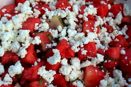 Watermelon and feta cheese salad with mint garnish.