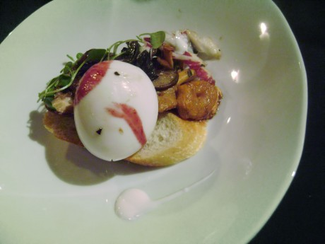 7 Poached Hen's egg with forest mushrooms and red wine reduction served on a crostini
