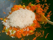 Beaten rice with carrots, onions and turmeric